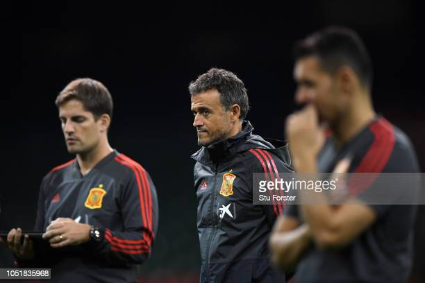 Luis Enrique, Head Coach of Spain gives his team instructions during a Spain training session whilst under a closed roof at Principality Stadium on...