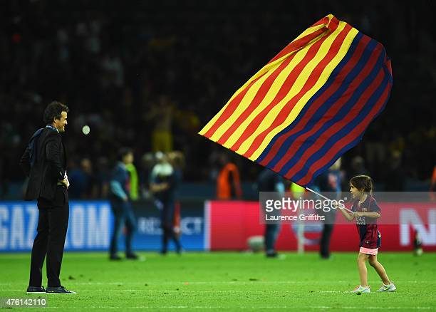 Luis Enrique manager of Barcelona and daughter Xana celebrate victory after the UEFA Champions League Final between Juventus and FC Barcelona at...