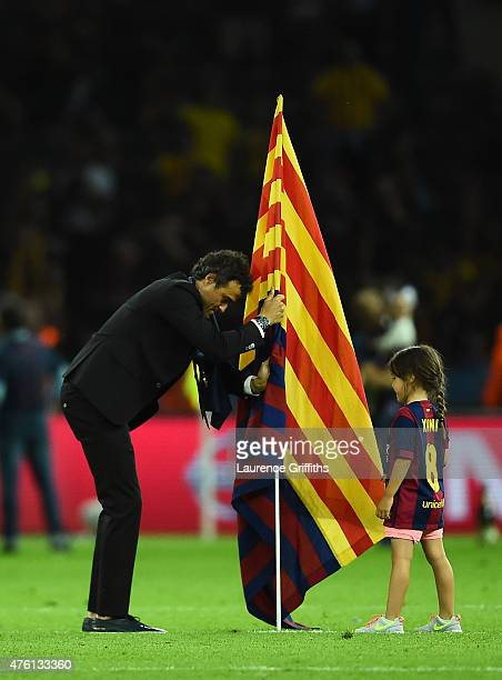 Luis Enrique manager of Barcelona places a Barcelona flag in the pitch after the UEFA Champions League Final between Juventus and FC Barcelona at...