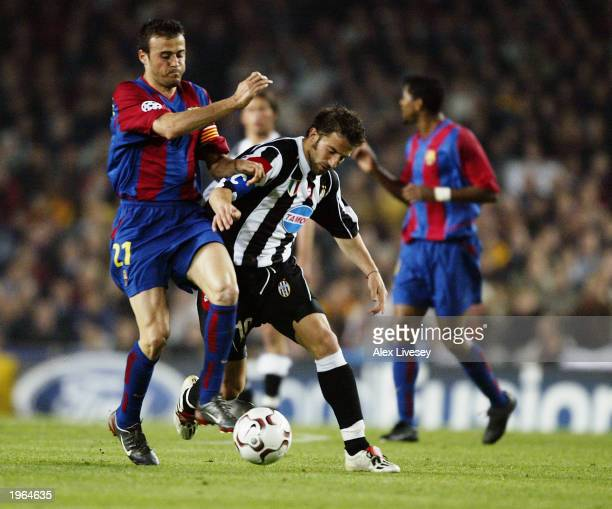 Luis Enrique of Barcelona holds the ball up against Alessandro Del Piero of Juventus during the UEFA Champions League QuarterFinal second leg match...