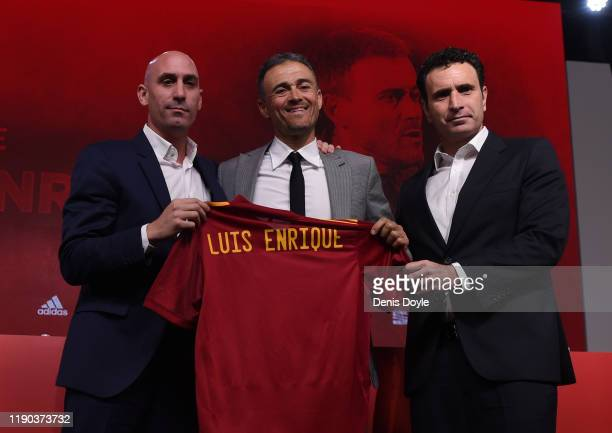 Luis Enrique poses alongside Spanish Football Federation President Luis Rubiales and Spanish Football Federation Sporting Director Jose Molina as he...