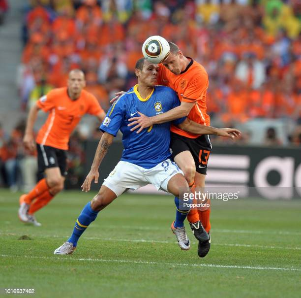Luis Fabiano of Brazil and Andre Ooijer of the Netherlands in action during the 2010 FIFA World Cup Quarter Final match between the Netherlands and...