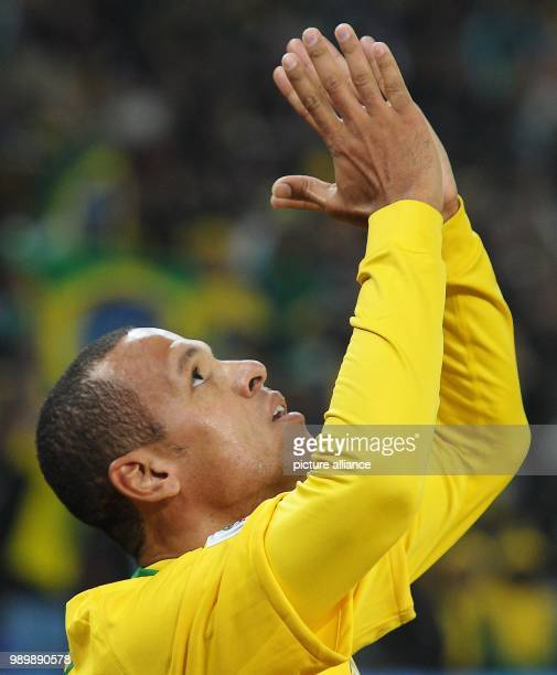 Luis Fabiano of Brazil celebrates after scoring the 10 during the FIFA World Cup 2010 group G match between Brazil and Ivory Coast at the Soccer City...