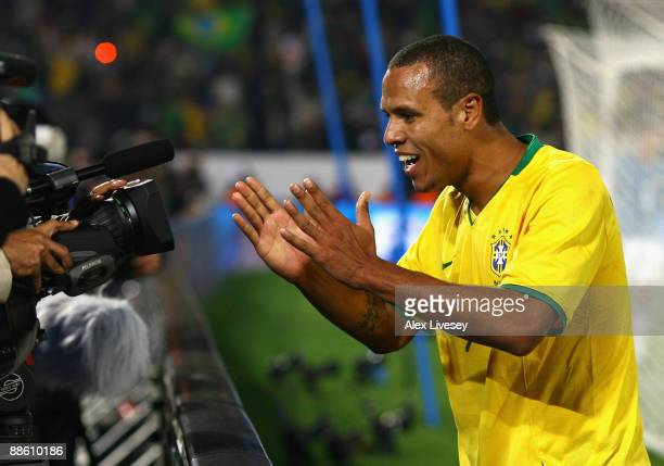 Luis Fabiano of Brazil celebrates into a TV camera after scoring his second goal during the FIFA Confederations Cup match between Italy and Brazil at...