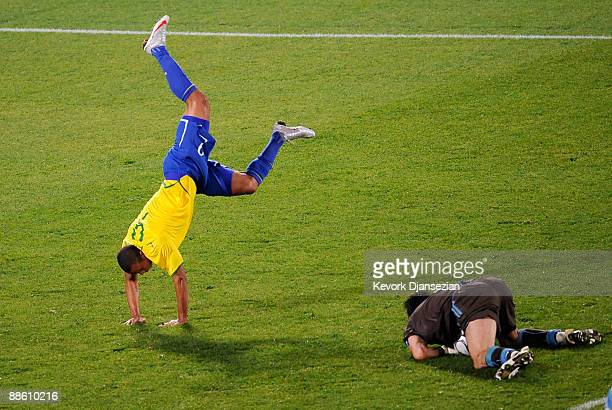 Luis Fabiano of Brazil goes up and over Gianluigi Buffon goalie of Italy after he blocked a shot during the FIFA Confederations Cup match between...