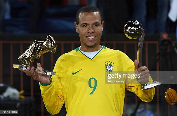 Luis Fabiano of Brazil poses with the adidas Silver Ball awarded to the second most outstanding player of the tournament and the adidas Golden Shoe...