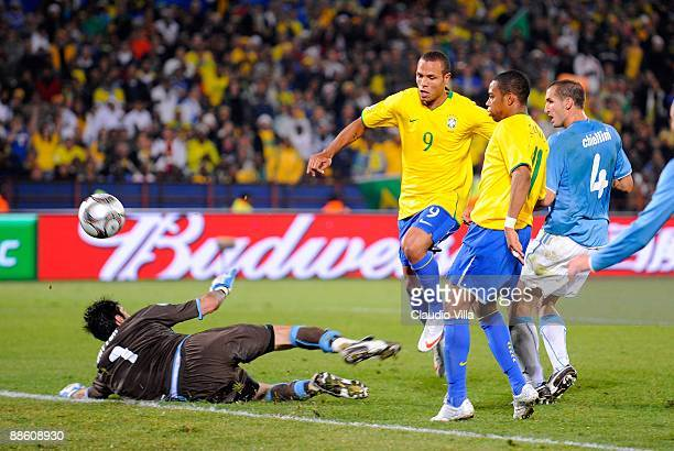 Luis Fabiano of Brazil scores the second goal during the FIFA Confederations Cup match between Italy and Brazil at the Loftus Versfeld Stadium on...