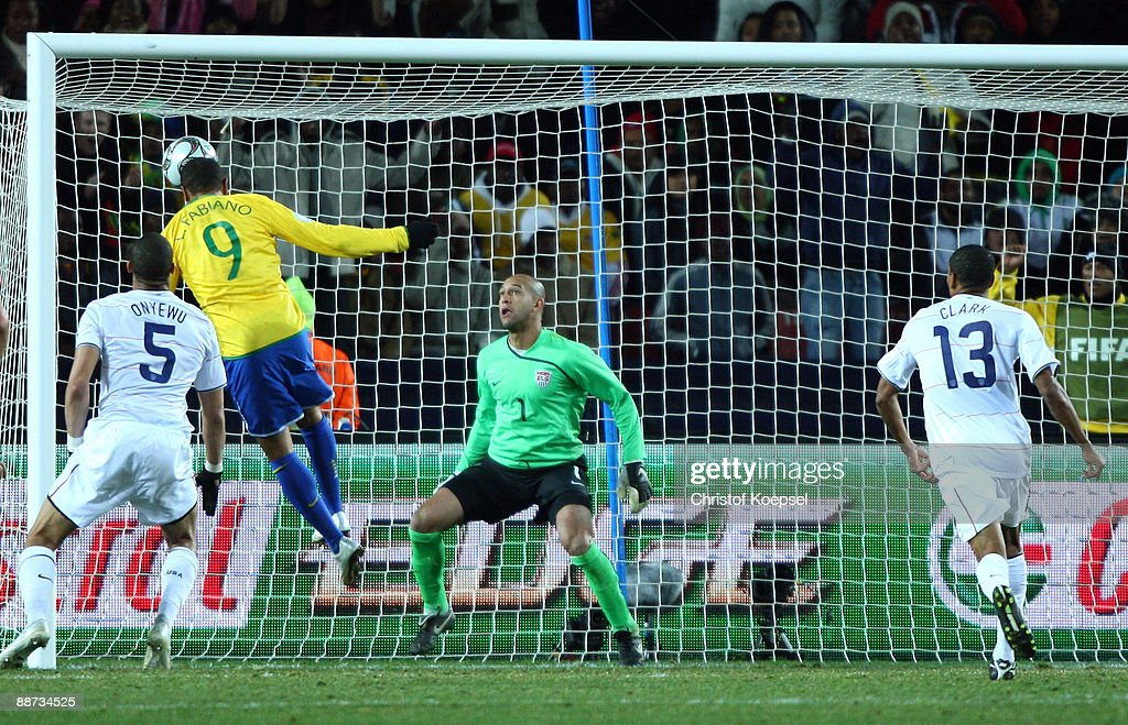 Luis Fabiano of Brazil scores the second goal (2nd-L) during the FIFA Confederations Cup Final between USA and Brazil at the Ellis Park Stadium on June 28, 2009 in Johannesburg, South Africa.