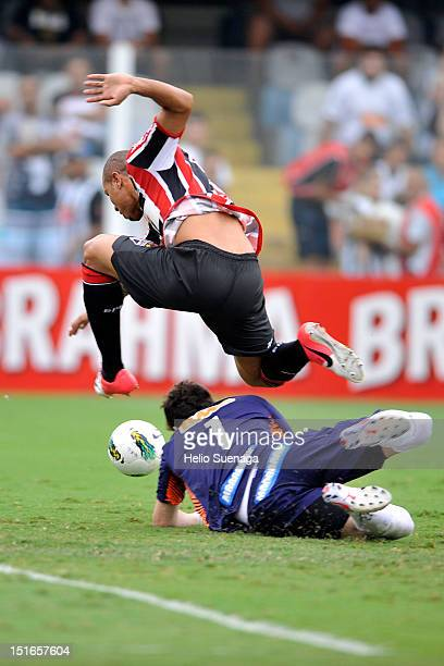 Luis Fabiano of Sao Paulo fights for the ball with Rafael Cabral goalkeeper of Santos during a match between Santos and Sao Paulo as part of the...