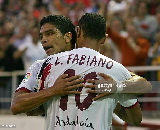Luis Fabiano of Sevilla celebrates with Renato after scoring their first goal during the Primera Liga match between Sevilla and Real Zaragoza at the...