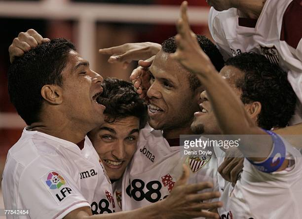 Luis Fabiano of Sevilla celebrates with Renato and Jesus Navas after scoring Sevilla's 3rd goal during the Primera Liga match between Sevilla and...
