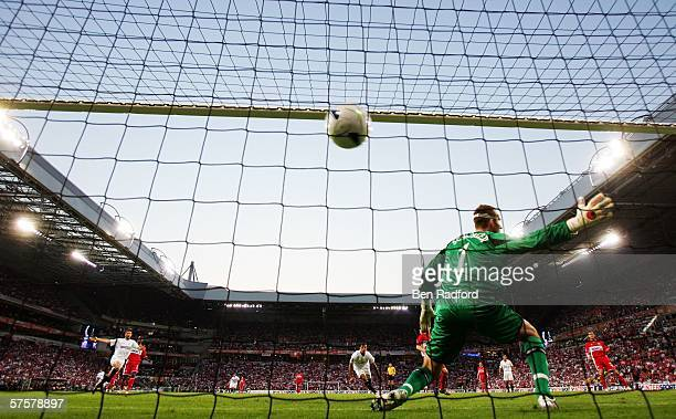 Luis Fabiano of Sevilla FC celebrates after he scored the first goal past goalkeeper Mark Schwarzer of Middlesbrough FC during the UEFA Cup final...