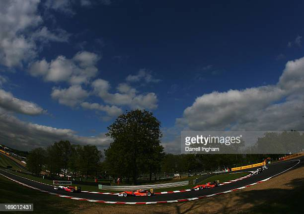 Luis Felipe Derani of Brazil drives the Fortec Motorsports Dallara F312 Mercedes round Druids Hill Bend ahead of Mitchell Gilbert and Roy Nissany...