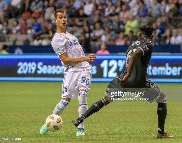 Luis Felipe of the San Jose Earthquakes and Alphonso Davies of the Vancouver Whitecaps fight for the ball at BC Place on September 1 2018 in...