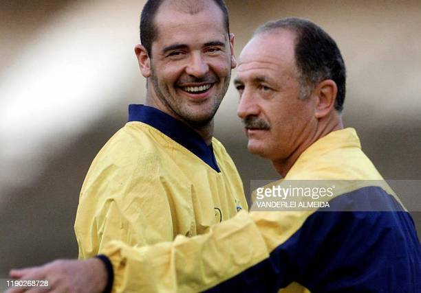 Luis Felipe Scolari coach of the Brazilian soccer team stands with team goalie Marcos during a practice round 14 August 2001 in Porto Alegre Brazil...