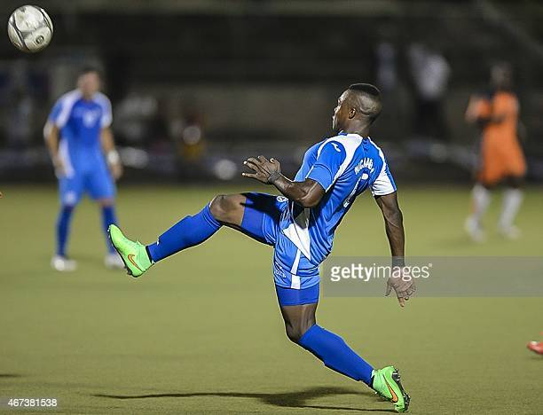 Luis Fernando Copete of the National Soccer Team of Nicaragua moves the ball against the National selection of Anguilla at the National Soccer...