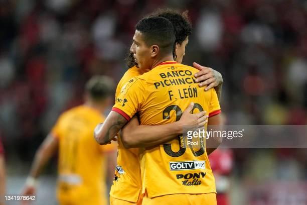Luis Fernando León embraces teammate Williams Riveros after a semi final first leg match between Flamengo and Barcelona SC as part of Copa CONMEBOL...