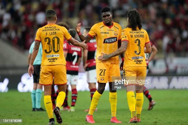 Luis Fernando León, Michael Carcelen and Williams Riveros of Barcelona SC greet after a semi final first leg match between Flamengo and Barcelona SC...