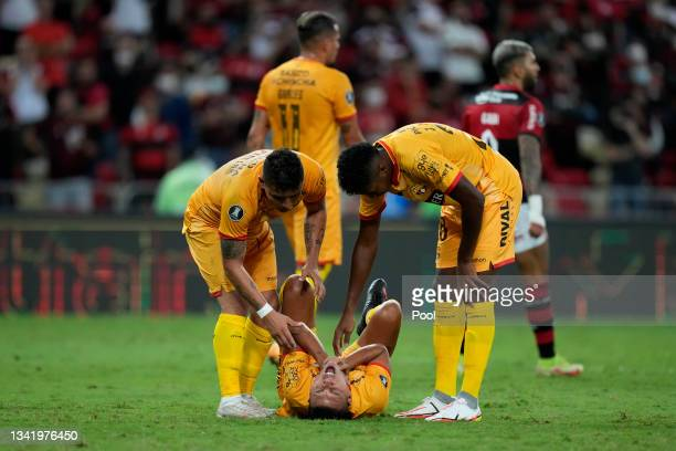 Luis Fernando León of Barcelona SC rects after being injured during a semi final first leg match between Flamengo and Barcelona SC as part of Copa...
