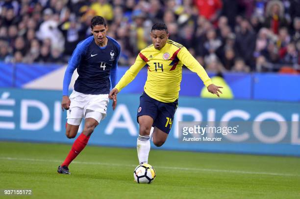 Luis Fernando Muriel of Colombia and Raphael Varane of France fight for the ball during the international friendly match between France and Colombia...
