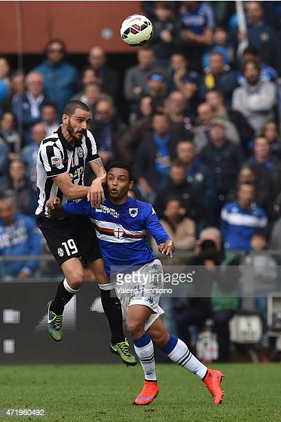 Luis Fernando Muriel of UC Sampdoria clashes with Leonardo Bonucci of Juventus FC during the Serie A match between UC Sampdoria and Juventus FC at...