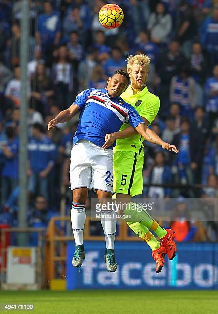 Luis Fernando Muriel of UC Sampdoria competes for the ball with Filip Helander of Hellas Verona FC during the Serie A match between UC Sampdoria and...