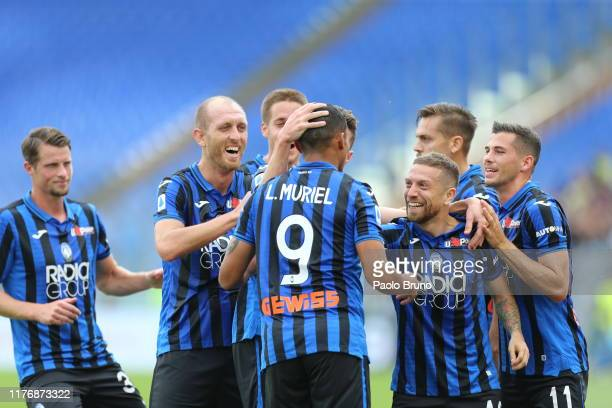 Luis Fernando Muriel with his teammates of Atalanta BC celebrates after scoring the team's second goal during the Serie A match between SS Lazio and...
