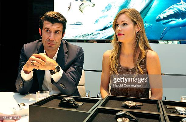 Luis Figo and Helen Svedin visit the IWC booth during the Salon International de la Haute Horlogerie 2014 at the Palexpo on January 21 2014 in Geneva...