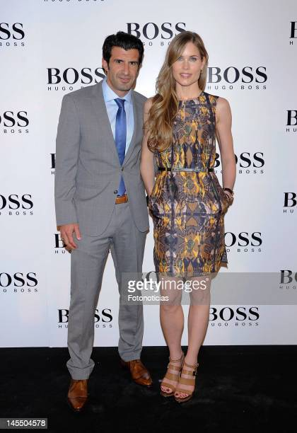 Luis Figo and Helen Swedin attend the new Hugo Boss Store Madrid Jorge Juan opening party at the Palacio de Cibeles on May 31 2012 in Madrid Spain