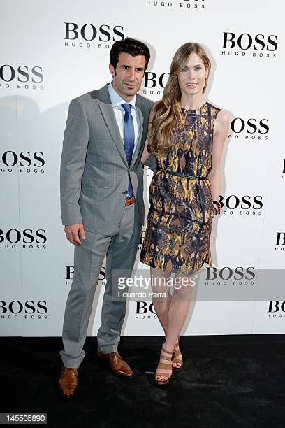Luis Figo and Helen Swedin attends Hubo Boss opening store party at Madrid City Hall on May 31 2012 in Madrid Spain