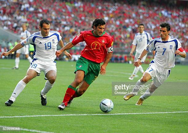 Luis Figo between Michail Kapsis and Theodoros Zagorakis