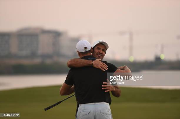Luis Figo congratulates Martin Kaymer at the 18th green during The Abu Dhabi Invitational at Yas Links Golf Course on January 13 2018 in Abu Dhabi...