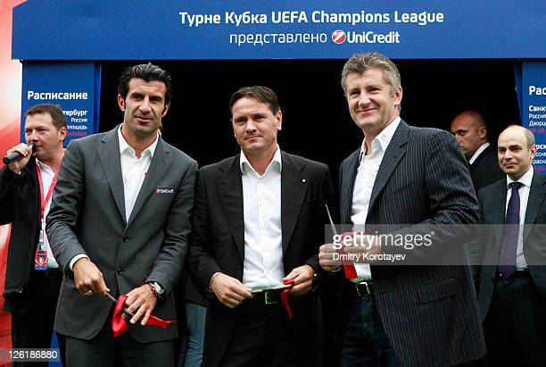 Luis Figo Dmitri Alenichev and Davor Suker cut tape during opening ceremony of the UEFA Champions League Trophy Tour 2011 on September 23 2011 in...