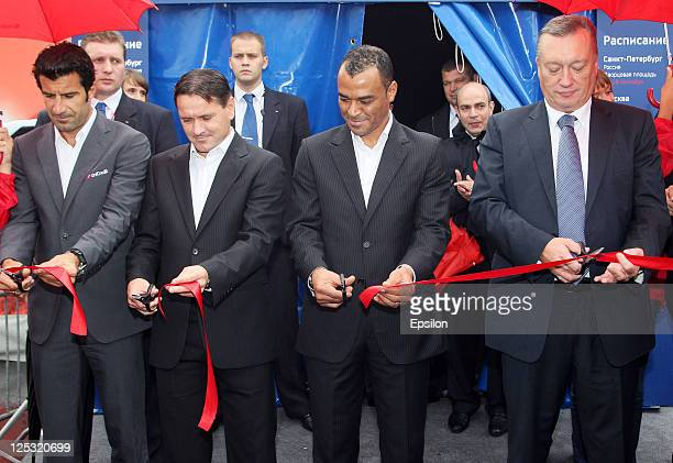 Luis Figo Dmitri Alenichev Cafu and Vadim Tulpanov cut tape during opening ceremony of the UEFA Champions League Trophy Tour 2011 on September 16...
