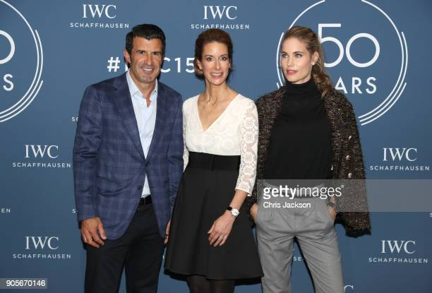 Luis Figo Franziska Gsell and Helen Svedin visit the IWC booth during the Maison's launch of its Jubilee Collection at the Salon International de la...