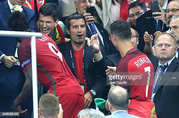 Luis Figo greets Cristiano Ronaldo of Portugal during the trophy ceremony of the UEFA Euro 2016 final between Portugal and France at Stade de France...