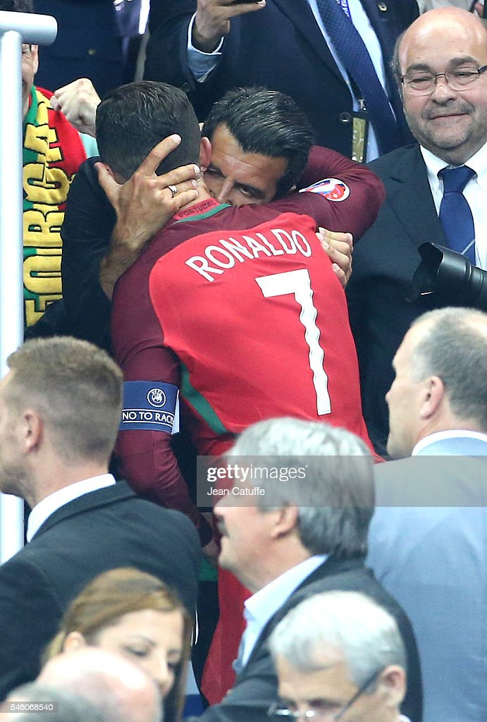Luis Figo greets Cristiano Ronaldo of Portugal during the trophy ceremony of the UEFA Euro 2016 final between Portugal and France at Stade de France on July 10, 2016 in Saint-Denis near Paris, France.