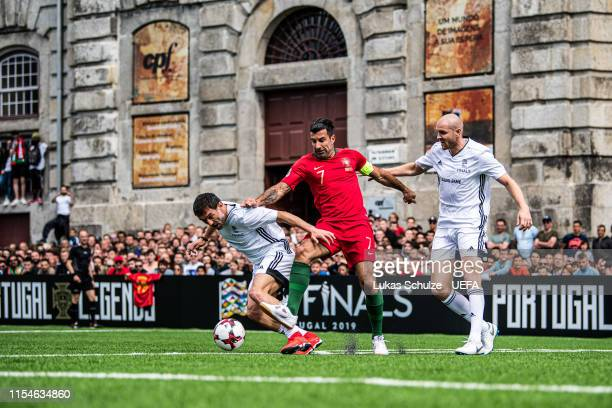 Luis Figo is attacked by Georgios Karagounis and Philippe Senderos during the match between the Portugal Legends and the UEFA Legends at Largo Amor...