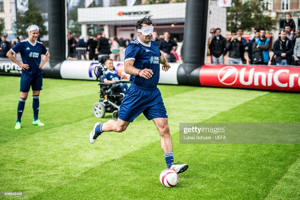 Luis Figo kicks a ball with a mask to feel like a blind player during the EqualGame Match at the Fan Zone ahead of the UEFA Europa League Final between Olympique de Marseille and Club Atletico de Madrid at Stade de Lyon on May 15, 2018 in Lyon, France.