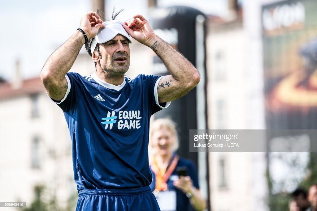 Luis Figo looks up after he kicks a ball with a mask to feel like a blind player during the EqualGame Match at the Fan Zone ahead of the UEFA Europa League Final between Olympique de Marseille and Club Atletico de Madrid at Stade de Lyon on May 15, 2018 in Lyon, France.