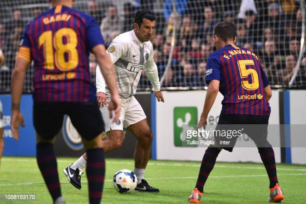 Luis Figo of Inter Forever is challenged by Fernando Navarro of Barcelona during the match between FC Internazionale Legends and FC Barcelona Legends...