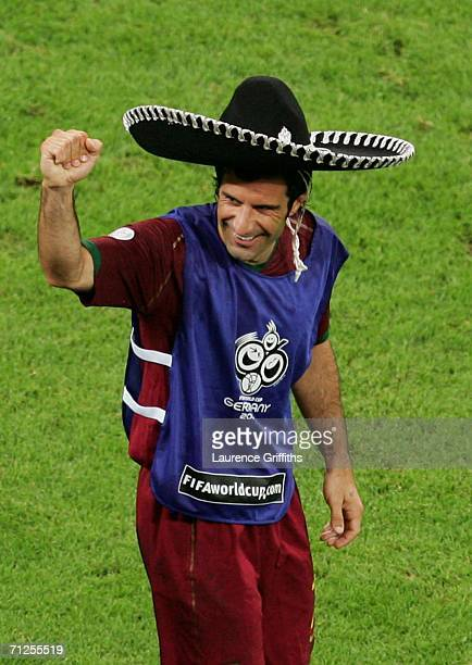 Luis Figo of Portugal celebrates on the sidelines after his team won the FIFA World Cup Germany 2006 Group D match between Portugal and Mexico 21 at...
