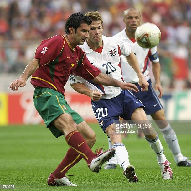 Luis Figo of Portugal challenges Brian McBride of the USA during the first half of the Portugal v USA, Group D, World Cup Group Stage match played at...