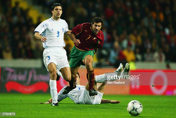 Luis Figo of Portugal evades the tackles from Theodoros Zagorakis and Panagiotis Fyssas of Greece during the International Friendly match between...