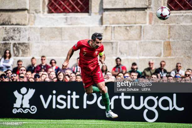Luis Figo of Portugal heads the ball during the match between the Portugal Legends and the UEFA Legends at Largo Amor de Perdicao ahead of the UEFA...
