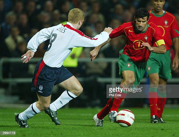 Luis Figo of Portugal is chased by Paul Scholes of England during the International Friendly match between Portugal and England at the Faro-Loule...