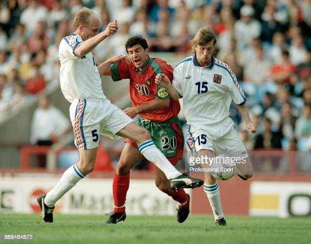 Luis Figo of Portugal is crowded out by Czech Republic pair Miroslav Kadlec and Michal Horák during a UEFA Euro 96 Quarter Final at Villa Park on...