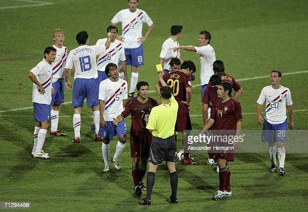 Luis Figo of Portugal is shown the yellow card by Referee Valentin Ivanov of Russia during the FIFA World Cup Germany 2006 Round of 16 match between...