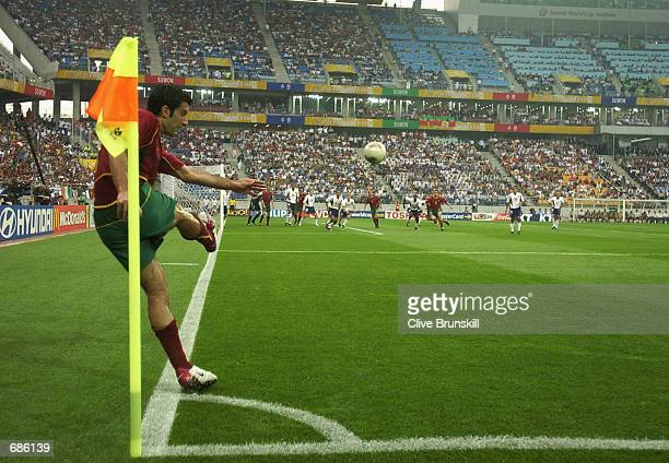 Luis Figo of Portugal takes a corner during the second half of the Portugal v USA, Group D, World Cup Group Stage match played at the Suwon World Cup...