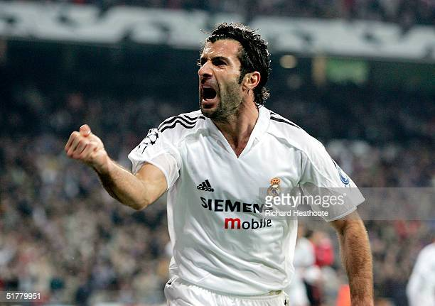 Luis Figo of Real Madrid celebrates the equaliser scored by Raul during the UEFA Champions League Group B match between Real Madrid and Bayer...